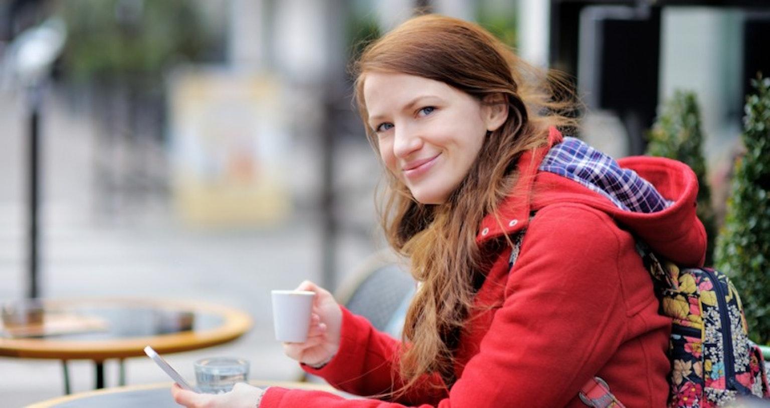 Girl smiling drinking coffee